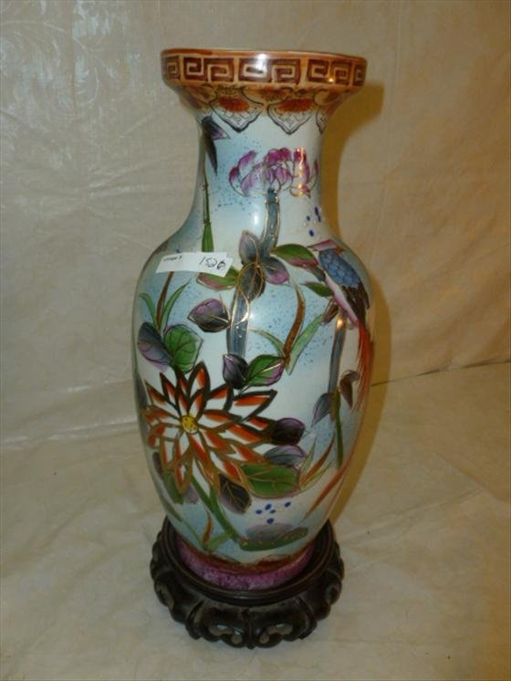 Oriental vase with footed wood base