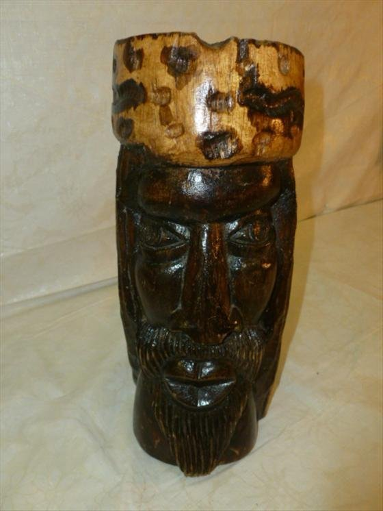 "Solid one piece wood carved and stained 11"" tall face o"