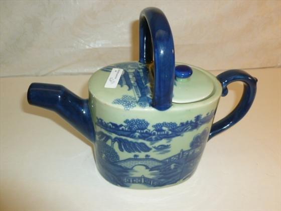 Oriental style tea pot in cobalt blue and light green
