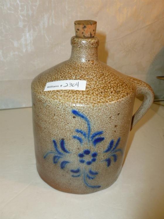 Stoneware jug tan with cobalt blue flower design