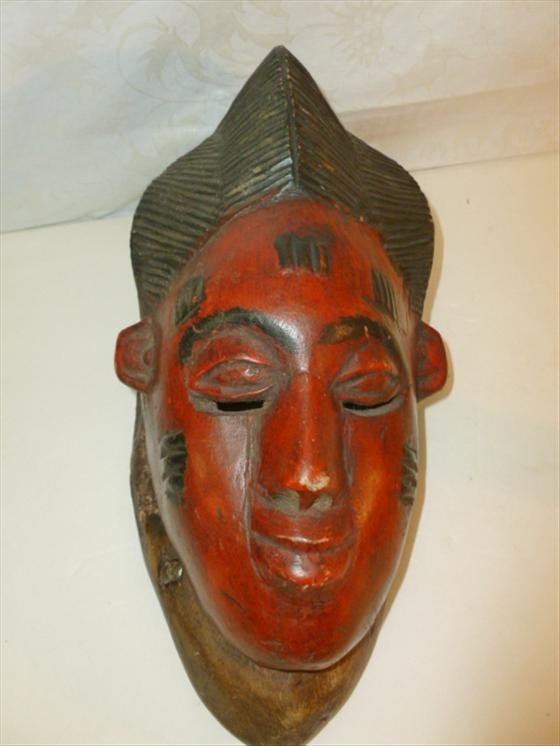 One piece carved African mask open eyes