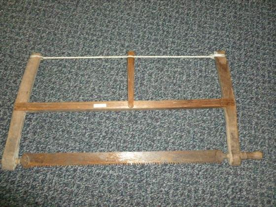 wood 2 man saw- with rope on top- 32 1/2 long