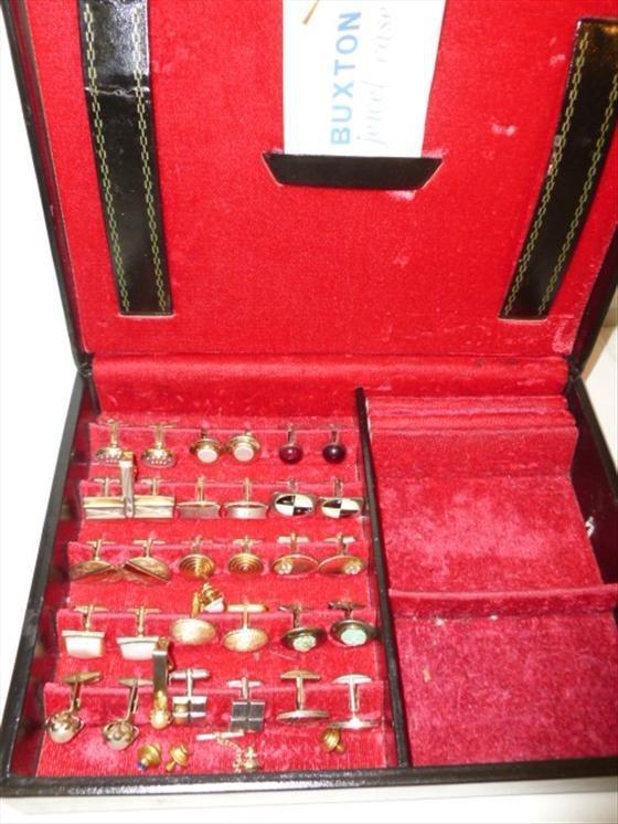 Men's jewelry box full of men's cuff links