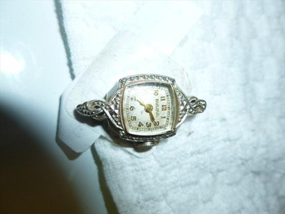 Ladies 14Kt white gold bezel Bulova watch