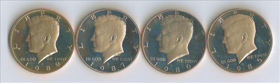 Four Kennedy Proof Clad Half Dollars