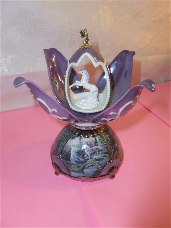 Porcelain music box open flower shaped with unicorn in
