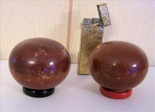 Salt & pepper shakers & lighter from his restaurant
