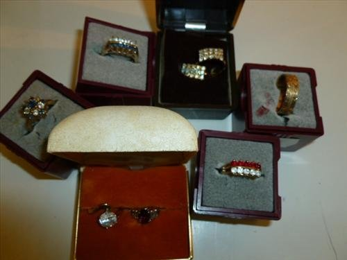 8 assorted ladies rings with boxes- colored stone some