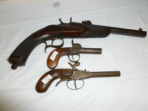3 antique pistols one with octagon barrel