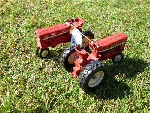 Pair International red tractors-die cast-rubber wheels