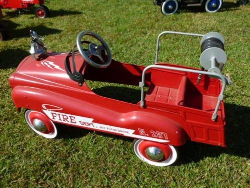 Pedal fire engine- burns novelty toy co made in Korea