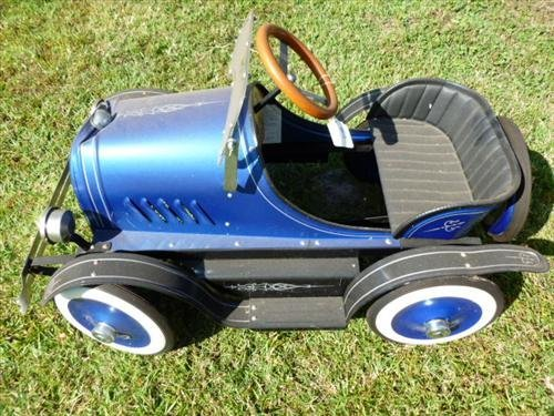 Pedal car blue roadster dented front on top-