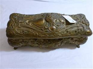 Gold tone die cast jewelry casket with pink lining