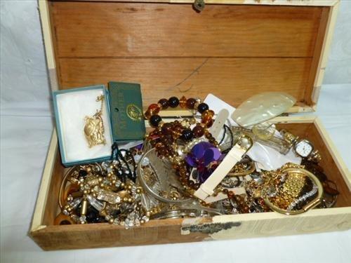 Box full of assorted costume jewelry