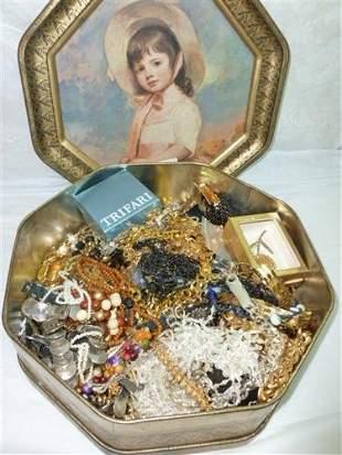 Large metal box full of costume jewelry