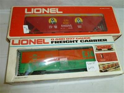 2 Lionel freight carrier and rolling Sun Raisins car