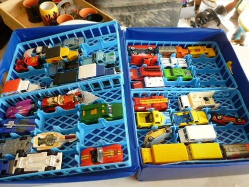 Plastic carrying case full of assorted hot wheel cars