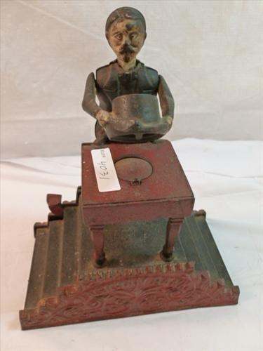Rare vintage -Cast Iron - Magician bank  name on  both