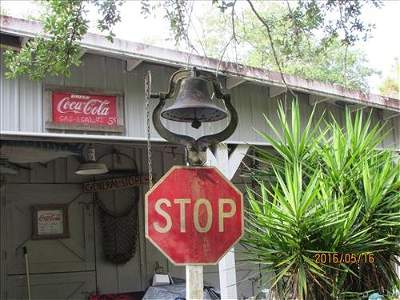 Large Outside Dinner Bell on Post with Stop Sign
