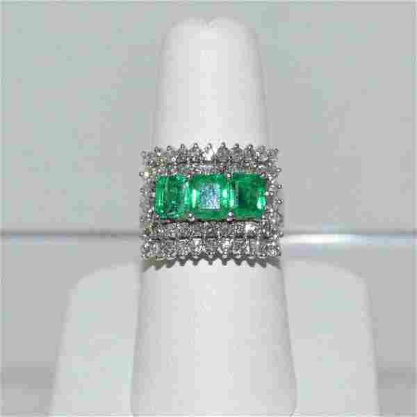 Platinum emerald and diamond cocktail ring