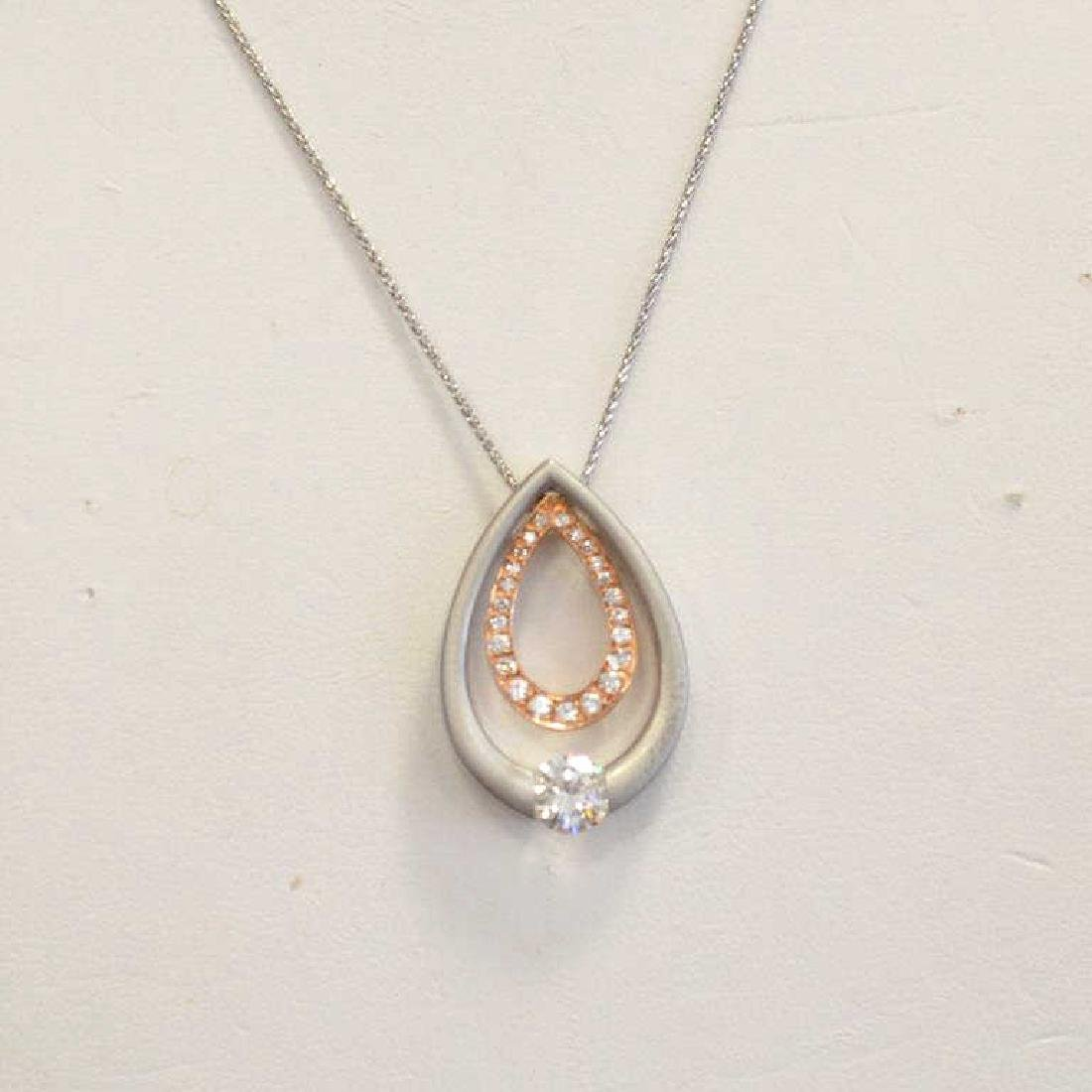 14kt two tone tension set diamond necklace