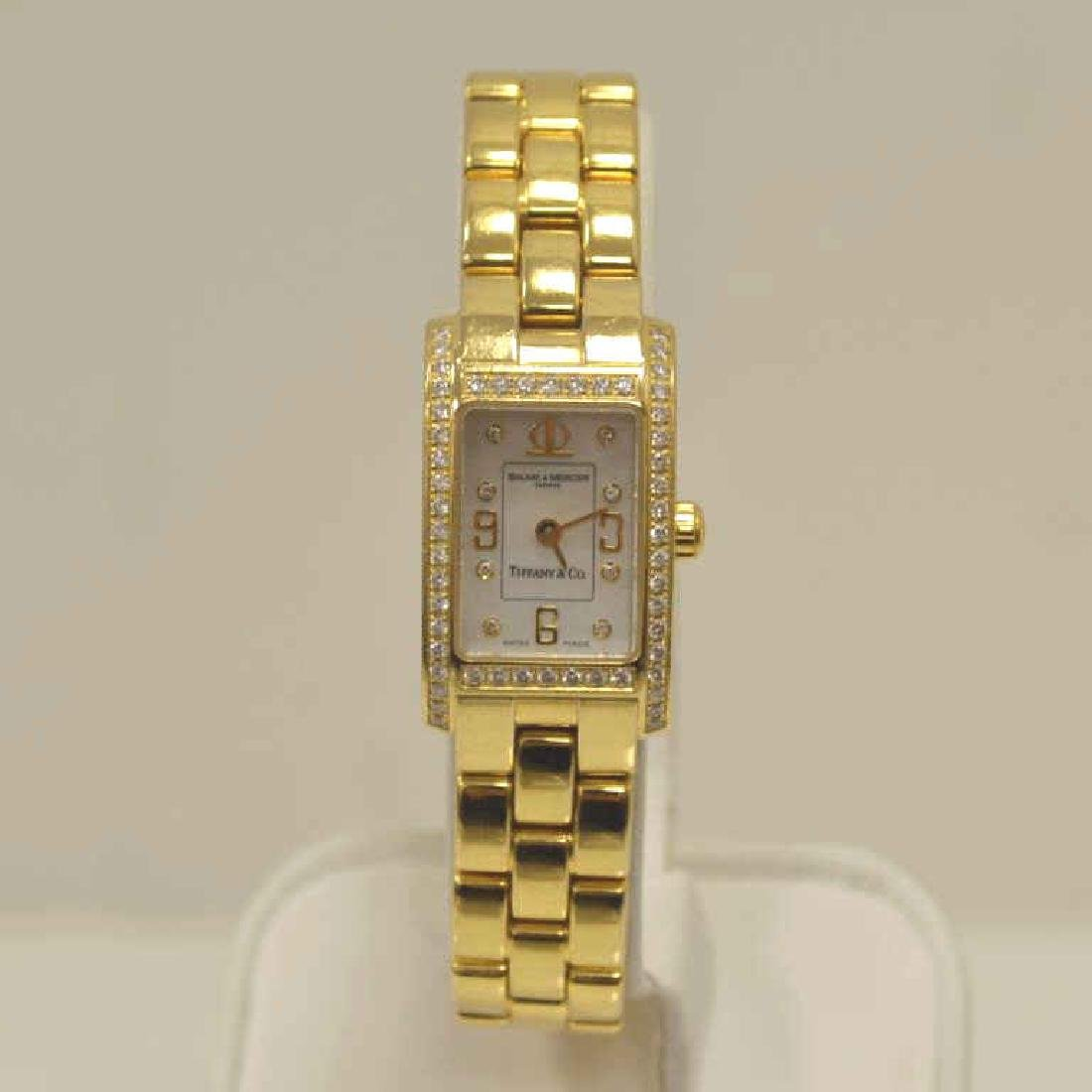 18kt Tiffany & Co., Baume & Mercier diamond watch