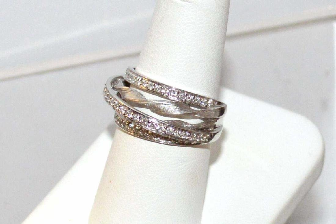 Lady's 14kt w/g Diamond fashion ring