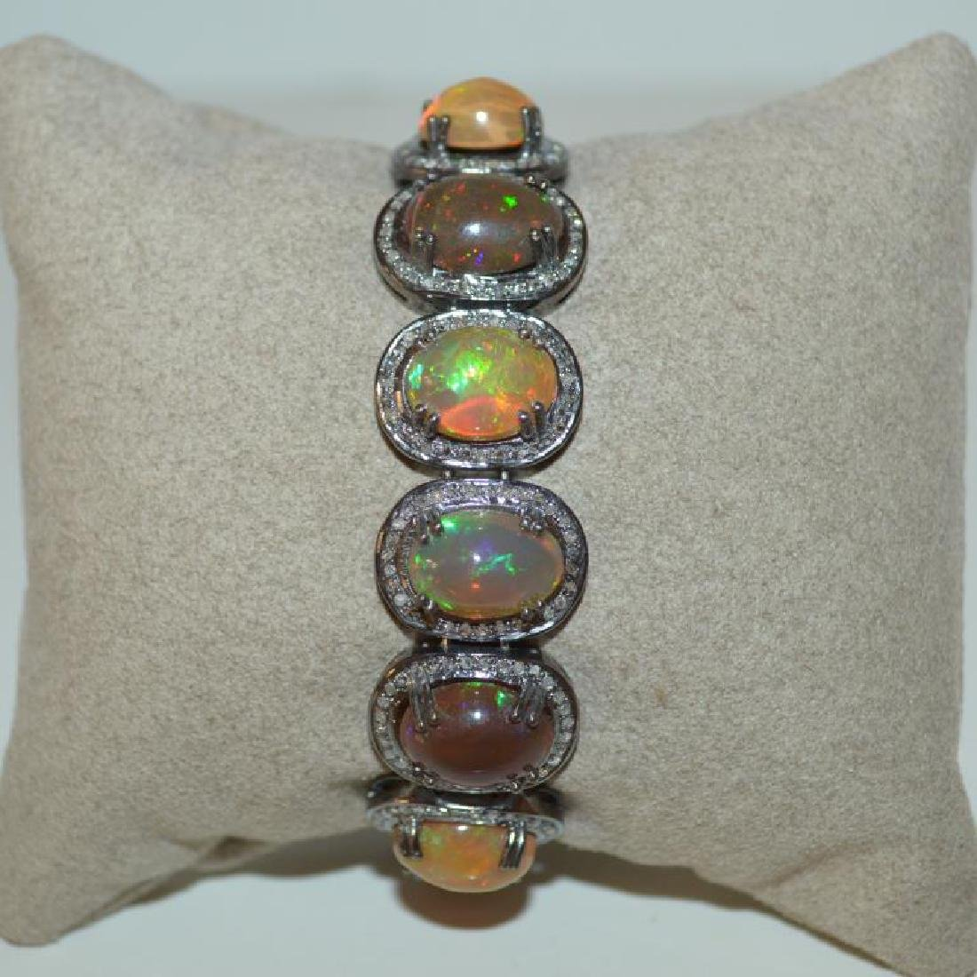Sterling silver opal and diamond bracelet