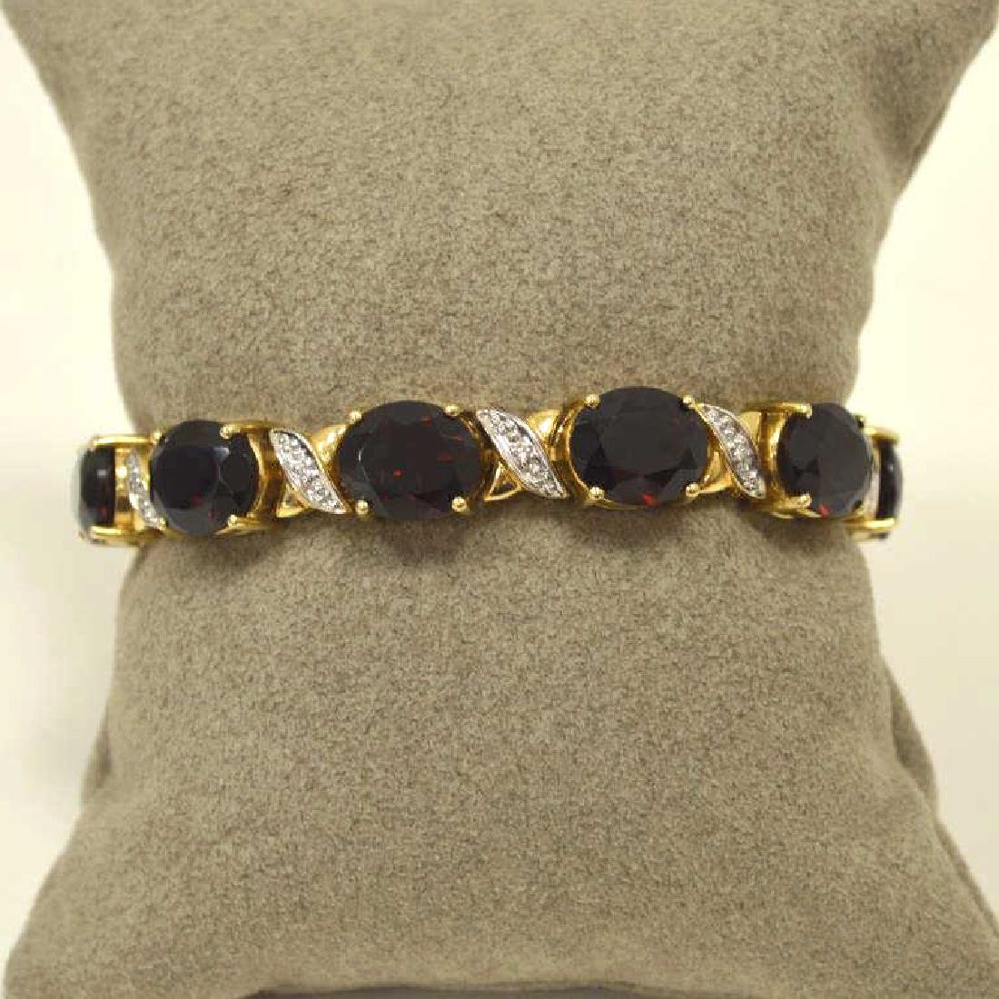 14kt yellow gold garnet bracelet