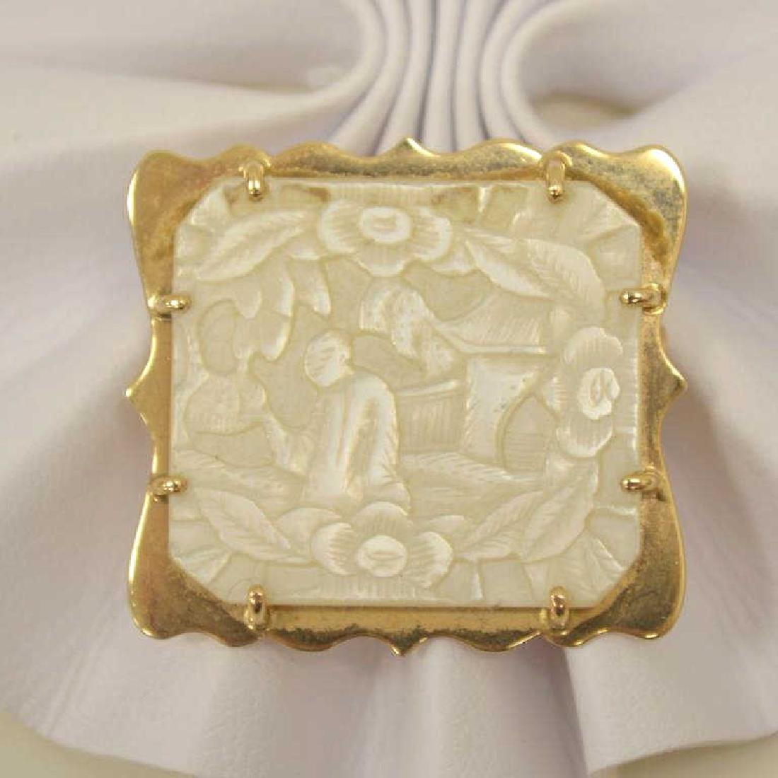 14kt yellow gold carved mother of pearl pendant