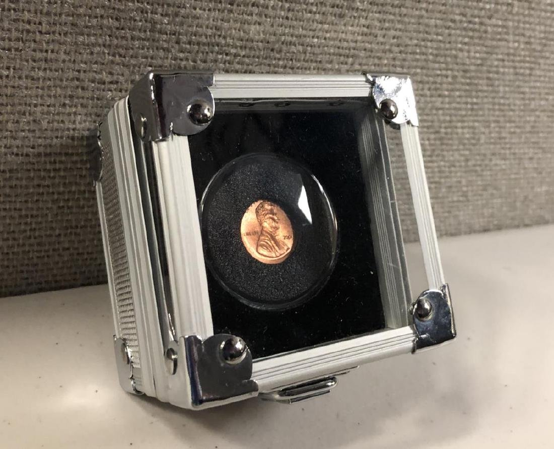 Off Center Lincoln Penny in Special Metal Case