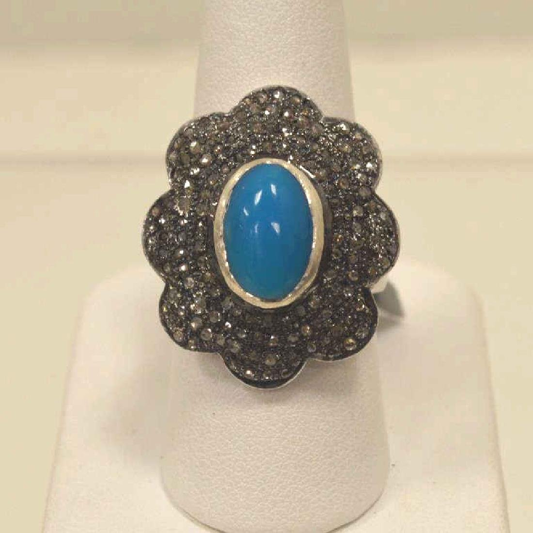 Sterling silver turquoise and diamond fashion ring