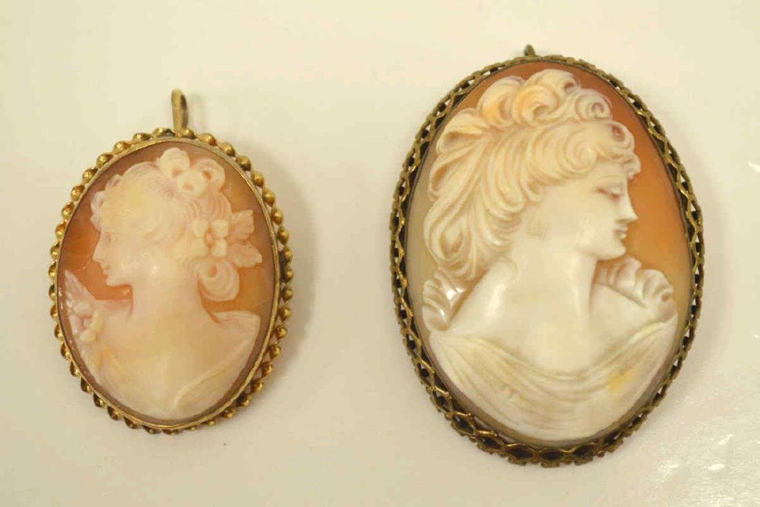 Pair of gold plated cameo pins