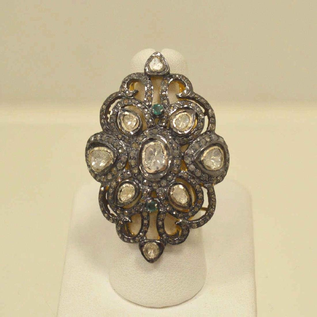 Sterling silver diamond and emerald fashion ring