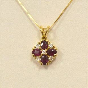 18kt yellow gold ruby and diamond pendant