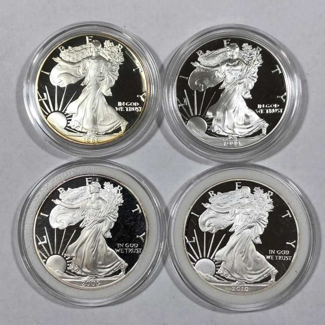 Lot of 4 Proof Silver Eagles in Capsules 1989-2010