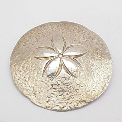 2022: Sterling silver sand dollar pin