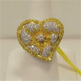 18kt white gold fancy yellow diamond heart ring