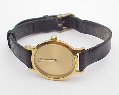 3003: Lady's Movado Watch; gold face