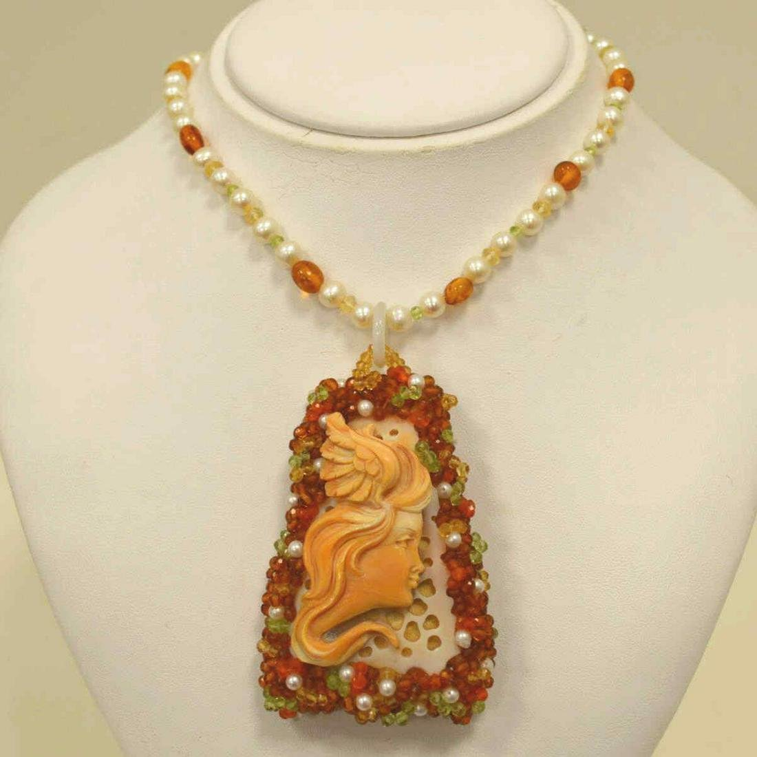 Carved cameo necklace by Carada