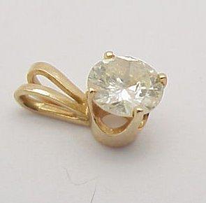 12: Diamond Pendant .69 ct. 14kt