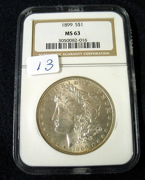 1013: 1899 Morgan Silver Dollar NGC MS63