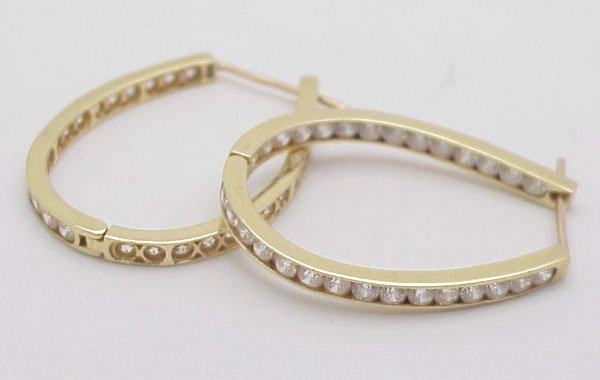 2: Oval hoop earrings white stones 14kt