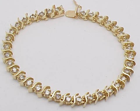 13: 3ct diamond tennis bracelet