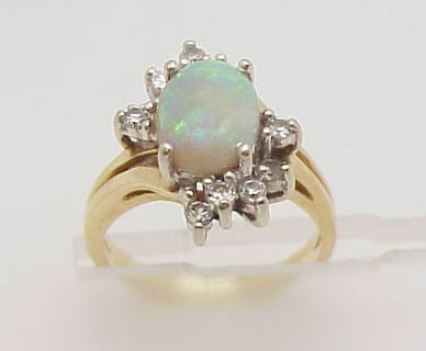 11: 14ky opal and diamond ring