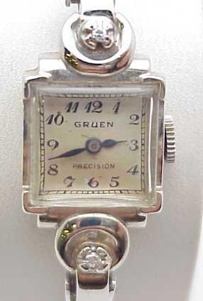 11: Lady's 14kwg Gruen diamond watch