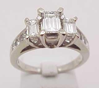 16: 14kwg emerald cut diamond ring