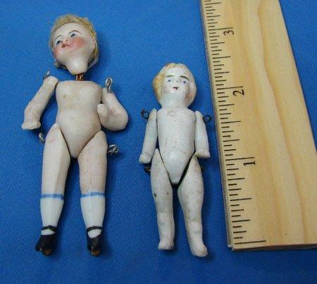 17: 2 Antique Porcelain Doll House Dolls