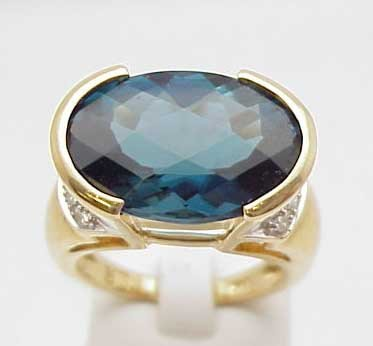 19: 14kyg blue topaz and diamond ring
