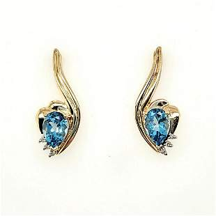 14kt yellow gold blue topaz and diamond earrings